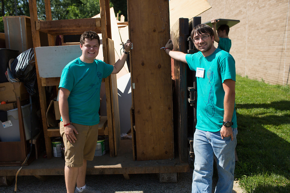 """Members pose next to a full dumpster during """"Circle the City with Service,"""" the Kiwanis Circle K International's 2015 Large Scale Service Project, on Wednesday, June 24, 2015, at the Friendship Westside Center for Excellence in Indianapolis. (Photo by James Brosher)"""