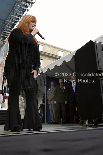 Country music singer Wynonna Judd performs her United Service Organization (USO) Concert at the Pentagon on May 21, 2004.  Enjoying the concert from the stage is from left to right:  President and Chief Executive Officer of the USO Edward Powell, Vice Chairman of the Joint Chiefs of Staff General Peter Pace, United States Marine Corps, and United States Secretary of Defense Donald H. Rumsfeld.  Judd performed for an audience of military and Department of Defense (DoD) civilians that included military personnel recovering from wounds received in Iraq and Afghanistan.  .Mandatory Credit: Helene Stikkel / DoD via CNP