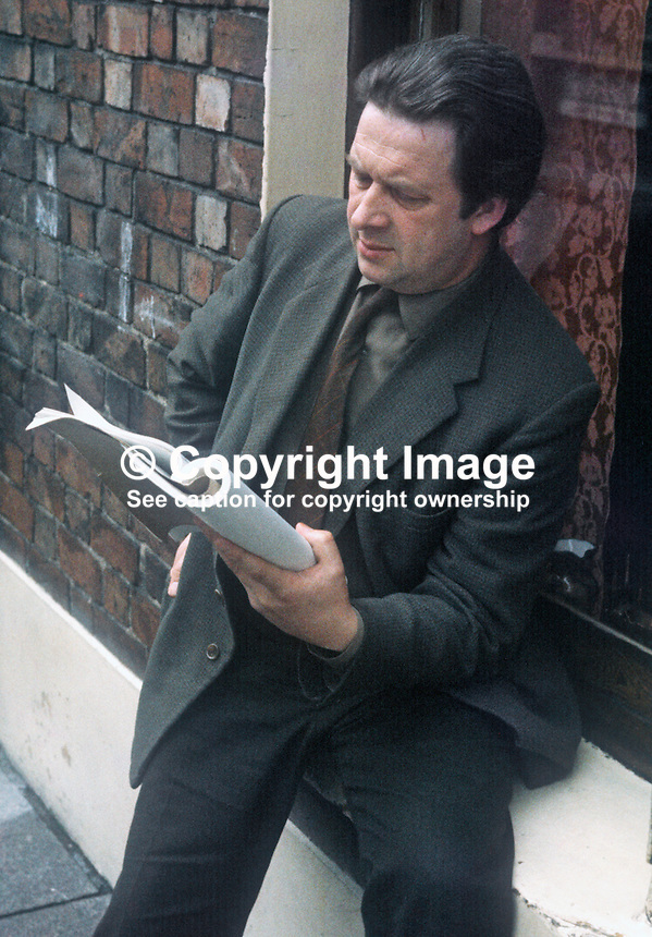 Playwright Sam Thompson photographed reading a script outside his home in Bankmore Street, Belfast, circa 1963. Sam's most successful play was Over the Bridge which exposed sectarianism in the shipyard. He was born 21st May 1916 and died of a heart attack 15th February 1965. 1965000096ST2<br />
