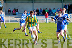 Lispole's Donncha Higgins in mid-stride being chased down by Renard's Kenneth Casey.