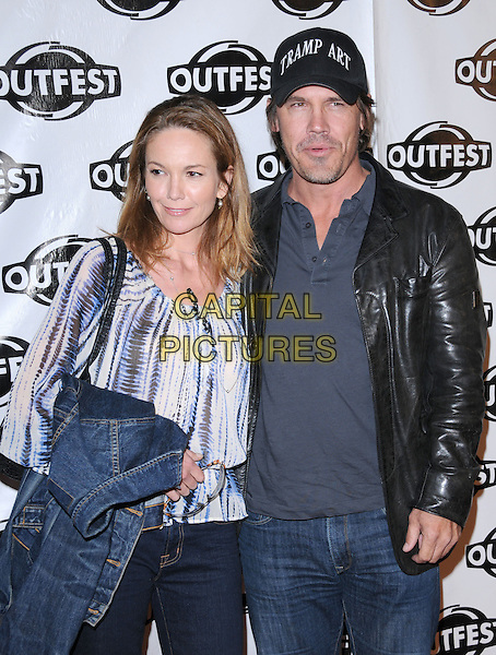 DIANE LANE & JOSH BROLIN.The 2009 Outfest Opening Night Gala of LA MISSION held at The Orpheum Theatre in Los Angeles, California on .July 9th, 2009.half length black blue white leather jacket pattern top baseball cap hat married husband wife .CAP/DVS.©Debbie VanStory/Capital Pictures.