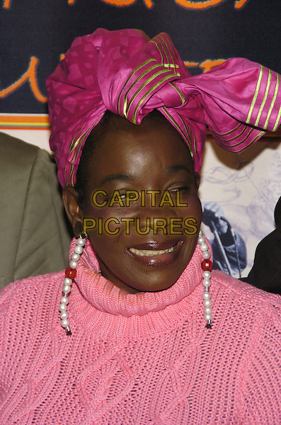 "RITA MARLEY.Premiere of the feature documentary ""Africa Unite"" at Walter Reade Theatre, Lincoln Center, as part of the New York African Film Festival, New York, New York, USA..April 7th, 2007.headshot portrait pink head scarf earrings.CAP/ADM/BL.©Bill Lyons/AdMedia/Capital Pictures *** Local Caption ***"