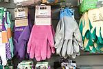 Gardening gloves display inside The Walled garden plant nursery, Benhall, Suffolk, England, UK
