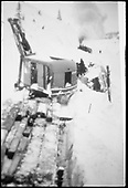 RGS Lorain shovel digging snow away from derailed Goose #3 just north of Lizard Head snowshed.  A rescue train waits in the background.  Same or better image at RD137-065.<br /> RGS  Lizard Head, CO  Taken by Wolford, Henry - ca. 1945
