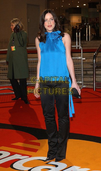 MICHELLE RYAN.The 2006 Brit Awards with Mastercard at Earls Court, London, UK..February 15th 2006.Ref: BEL.full length blue turquoise sleeveless top gathered corsage black trousers brits.www.capitalpictures.com.sales@capitalpictures.com.© Capital Pictures.
