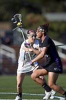 University at Albany midfielder Ariana Parker (14) on the attack as Boston College midfielder Kristin Igoe (21) defends. University at Albany defeated Boston College, 11-10, at Newton Campus Field, on March 30, 2011.