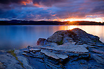Idaho, Coeur d'Alene, Lake Coeur d'Alene. A view from Tubbs Hill with rock at sunset.