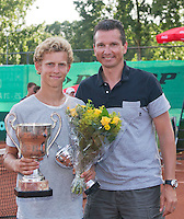 August 9, 2014, Netherlands, Rotterdam, TV Victoria, Tennis, National Junior Championships, NJK,  Prize giving, Richard Krajicek with Michiel de Krom  , winner boys 16 years<br /> Photo: Tennisimages/Henk Koster