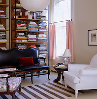 Floor-to-ceiling bookcases provide ample storage in the living room
