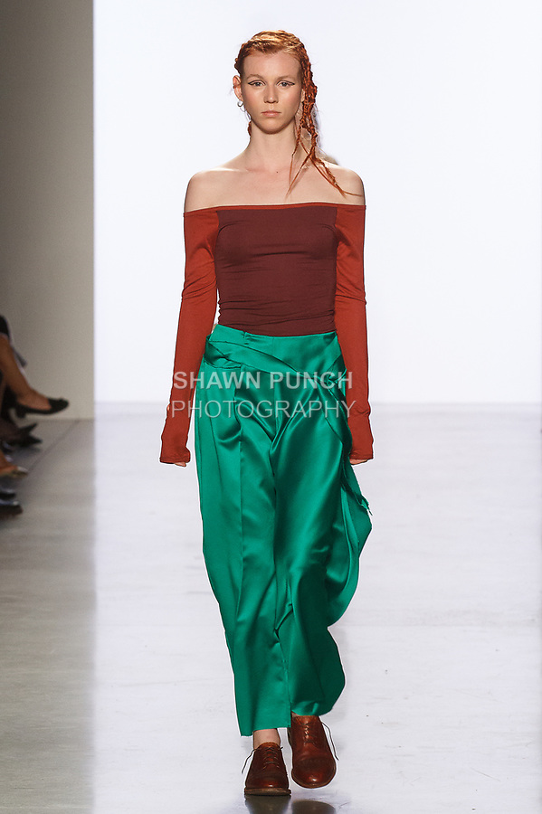 Model walks runway in an outfit by Regina Kim, for the 2017 Pratt fashion show on May 4, 2017 at Spring Studios in New York City.