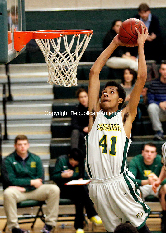 WATERBURY, CT- 12 March 2015-031215CM08-  Holy Cross' Shawn Coles goes up for a dunk during their Class S state tournament game against Haddam-Killingworth in Waterbury on Thursday. Cross won, 78-67.   Christopher Massa Republican-American