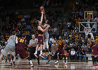 Richard Solomon of California tips off during overtime game against Arizona State at Haas Pavilion in Berkeley, California on January 29th, 2014.   Arizona State defeated California, 89-78.