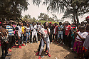 Benin - Grand Popo - Schoolchildren dance on the beach to celebrate Easter holiday. One of the most popular tourist destination in Benin due to its nice beaches, the city of Grand Popo and its surrounding villages have suffered severe coastal erosion for the past decades.