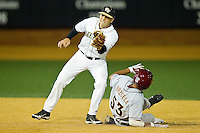 Mark Rhine #2 of the Wake Forest Demon Deacons fields a throw as Jose Brizuela #53 of the Florida State Seminoles attempts to steal second base at Wake Forest Baseball Park on March 24, 2012 in Winston-Salem, North Carolina.  The Seminoles defeated the Demon Deacons 3-2.  (Brian Westerholt/Four Seam Images)