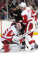 03/02/11 Anaheim, CA: Detroit Red Wings goalie Jimmy Howard #35, defenseman Jakub Kindl #4 and Anaheim Ducks left wing Brad Winchester #19 during an NHL game between the Detroit Red Wings and the Anaheim Ducks at the Honda Center. The Ducks defeated the Red Wings 2-1 in OT.