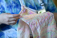 """Artist Marie Haley holds a scarf she dyed using a water marbling technique, Sunday, January 12, 2020 during a water marbling class at Art & Soul Studios NWA in Rogers. Check out nwaonline.com/200113Daily/ for today's photo gallery.<br /> (NWA Democrat-Gazette/Charlie Kaijo)<br /> <br /> Marie Haley, artist and owner of Art & Soul Studios, lead a class to show art enthusiasts an innovative approach to dying fabrics. The water marbling technique is from the 15th century. Artists drop paints into a bath of seaweed solution that rises to the top. Afterwards, they use tools to create designs with the paint before dipping their fabric into the bath. <br /> <br /> Visitors who tried the art style shared their experience of the process saying, """"This is satisfying because you can't mess up. It doesn't take that long. You get instant gratification."""" And """"What it turns out to be might not be what you expected."""""""