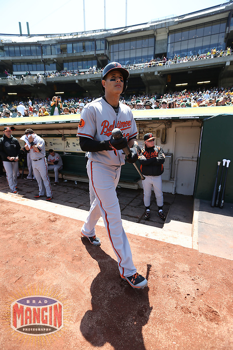 OAKLAND, CA - APRIL 28:  Manny Machado #13 of the Baltimore Orioles gets ready in the dugout before the game against the Oakland Athletics on Sunday, April 28, 2013 at The O.co Coliseum in Oakland, California. Photo by Brad Mangin
