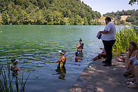 Lucerne, SWITZERLAND, 12th July 2018, Friday  FISA World Cup series, No.3, Lake Rotsee, Lucerne, Canadian and Australian, Athletes, take a dip in the lake,