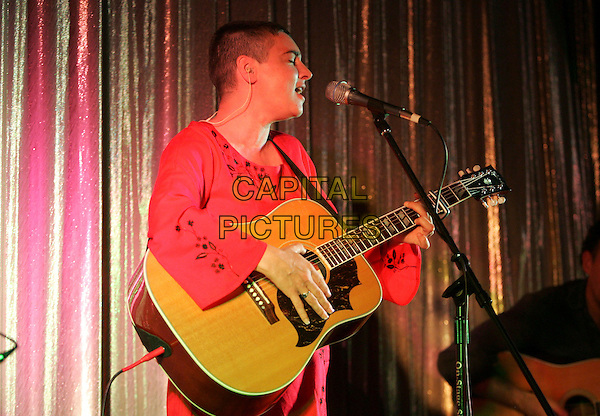 ATMOSPHERE.Performs live to a sold out crowd at The Silent Movie Theatre in West Hollywood, California, USA.. June 19th, 2007       .stage concert live gig performance music singing microphone half length red kaftan guitar .CAP/DVS.©Debbie VanStory/Capital Pictures