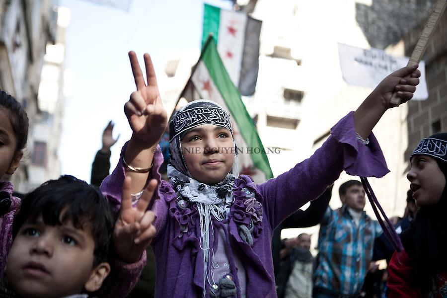 Friday protest in Bustan Al Kaser, Aleppo, where young people and children were singing songs against Bashar and the Syrian Regime..Manifestation du vendredi dans le quartier de Bustan Al Kaser à Alep. Des enfants et jeunes syriens chantent contre Bashar et le régime syrien.