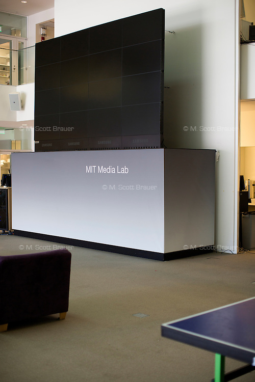 A large array of LCDs sits in a common area of MIT's Media Lab in Cambridge, Massachusetts, USA.