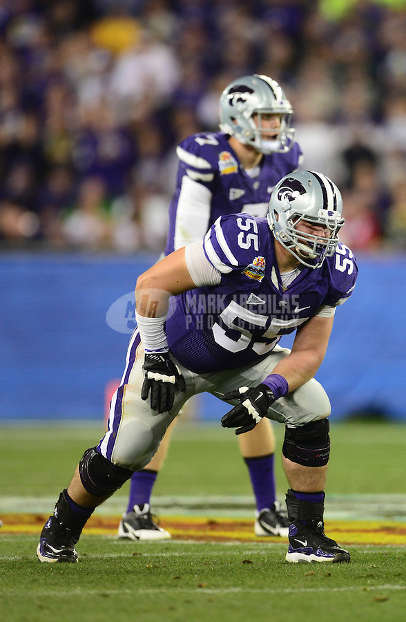 Jan. 3, 2013; Glendale, AZ, USA: Kansas State Wildcats offensive lineman Cody Whitehair (55) against the Oregon Ducks during the 2013 Fiesta Bowl at University of Phoenix Stadium. Oregon defeated Kansas State 35-17. Mandatory Credit: Mark J. Rebilas-