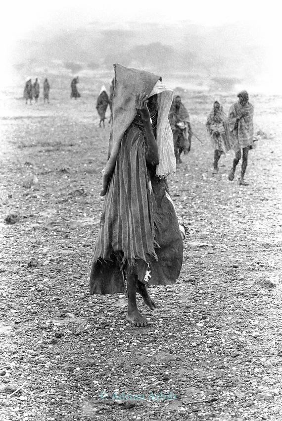 A Turkana woman arrives for food during a famine relief operation on the edge of the Suguta Valley.<br /> Northern Kenya. <br /> These nomadic herders have left the valley for the first time in their lives so bad was the drought which hit their region.