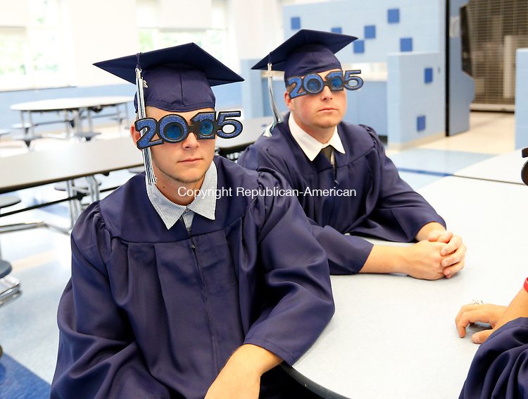Oxford, CT- 15 June 2015-061515CM09-  Oxford High School graduates Dale Keller, left, and Tim Stordy sport 2015 glasses before the start commencement exercises in Oxford on Monday.   Christopher Massa Republican-American