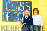 Sixth class student Grace McLoughlin from Caherleaheen NS has never missed a day of school in 8 years pictured with principal Mary Connolly