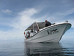 Palau, Micronesia -- Dive boat in the vastness of the ocean.