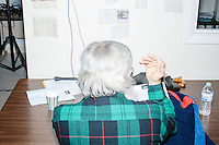 Anthony Nino (green plaid), of Amherst, NH, calls potential voters from the phonebank at the campaign headquarters of Kentucky senator and Republican presidential candidate Rand Paul in Manchester, New Hampshire. At the time, Paul was visiting the office to greet supporters and call voters.