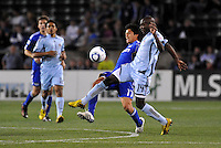 Roger Espinoza #17, Omar Cummings...Kansas City Wizards defeated Colorado Rapids 1-0 at Community America Ballpark, Kansas City, Kansas.