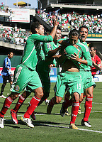 Luis Miguel Noriega (19) celebrates his goal with teammates. Mexico defeated Nicaragua 2-0 during the First Round of the 2009 CONCACAF Gold Cup at the Oakland, Coliseum in Oakland, California on July 5, 2009.