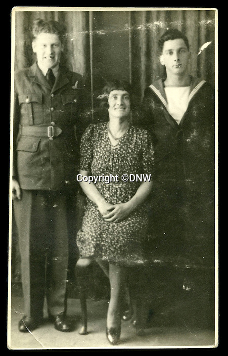 BNPS.co.uk (01202 558833)<br /> Pic: DNW/BNPS<br /> <br /> Stephen(left) with his mother Sarah and brother John during the war.<br /> <br /> An incredibly poignant poem left by a grieving mother in her war hero son's flying log book has been uncovered to reveal the devastation his death had on her.<br /> <br /> Sarah Burns was so heartbroken at the loss of son Stephen - who flew on the famous Dambusters Raid - that she slept with his spare RAF uniform for solace.<br /> <br /> She also penned a touching poem in his logbook alongside the signatures of RAF legends Guy Gibson and Sir Leonard Cheshire. The items are now being sold by Dix Noonan Webb.