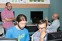 Richard Barnes, of Berkeley, Calif., (left) and John Casellas Connors, of Somerville, Mass., work together at the Metric Geometry and Gerrymandering Group (MGGG) hackathon at the Data Lab in the Tisch Library at Tufts University in Medford, Massachusetts, USA, on Thurs., Aug. 10, 2017. Barnes is a Ph.D. student in Computational Science at University of California, Berkeley. Connors is a post-doctoral associate at Boston University at the Frederick S. Pardee Center for the Study of the Longer-Range Future. The two were working on a programming library for computing compactness measures of voting districts. The hackathon is part of the first in a series of Geometry of Redistricting workshops put on by the MGGG. Academics, Geographic Information Systems (GIS) professionals, and legal professionals worked together to build tools useful in analyzing voting district data around the country.