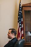 Congressman Jim Bridenstine works in his office before a conference call in the Cannon House Office Building on Sept. 19, 2013.