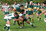 Pukekohe flanker P. Halia is taken by several tacklers. Counties Manukau Premier Club Rugby, Pukekohe v Manurewa  played at the Colin Lawrie field, on the 17th of April 2006. Manurewa won 20 - 18.