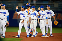 Florida Gators Andrew Baker (35), Nelson Maldonado (27), Shane Shifflett (5), and Jordan Butler (15) celebrate after a game against the Siena Saints on February 16, 2018 at Alfred A. McKethan Stadium in Gainesville, Florida.  Florida defeated Siena 7-1.  (Mike Janes/Four Seam Images)