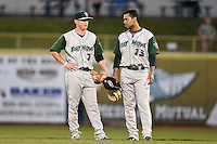 Fort Wayne TinCaps second baseman Josh VanMeter (7) and second baseman Fernando Perez (13) in between action during a game against the Lake County Captains on August 21, 2014 at Classic Park in Eastlake, Ohio.  Lake County defeated Fort Wayne 7-8.  (Mike Janes/Four Seam Images)