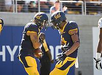 Chris Harper of California celebrates with Kenny Lawler of California after Harper scored a touchdown at Memorial Stadium in Berkeley, California on October 5th, 2013.  Washington State defeated California, 44-22.