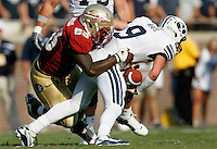 TALLAHASSEE, FL 9/18/10-FSU-BYU FB10 CH-Florida State's Everett Dawkins tackles Brigham Young's Jake Heaps during second half action Saturday at Doak Campbell Stadium in Tallahassee. The Seminoles beat the Cougars 34-10..COLIN HACKLEY PHOTO