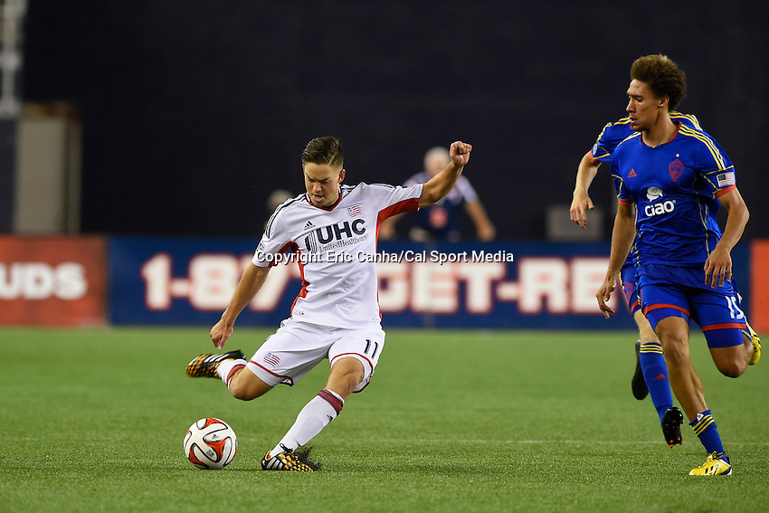 July 30, 2014 - Foxborough, Massachusetts, U.S. - New England Revolution's Kelyn Rowe (11) passes the ball in front of Colorado Rapids' Chris Klute (15)during the MLS game between the Colorado Rapids and the New England Revolution held at Gillette Stadium in Foxborough Massachusetts. The New England Revolution defeated the Colorado Rapids 3-0. Eric Canha/CSM