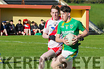 Conor Geaney, Castlegregory gets to grips with the ball as Ruairi O Beaglaoich, An Ghaeltacht, gives chase during the West Kerry Minor final at Lispole last Saturday afternoon.