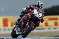 Jamie Stauffer (AUS) riding the Honda CBR1000RR of the Team Honda Racing exits turn 6 during a qualifying session on day one of round one of the 2013 FIM World Superbike Championship at Phillip Island, Australia.