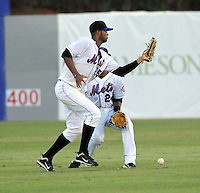 Outfielder Julio Concepcion (25) of the Kingsport Mets, Appalachian League affiliate of the New York Mets, drops a pop fly in a game against the Burlington Royals on August 20, 2011, at Hunter Wright Stadium in Kingsport, Tennessee. Kingsport defeated Burlington, 17-14. (Tom Priddy/Four Seam Images)