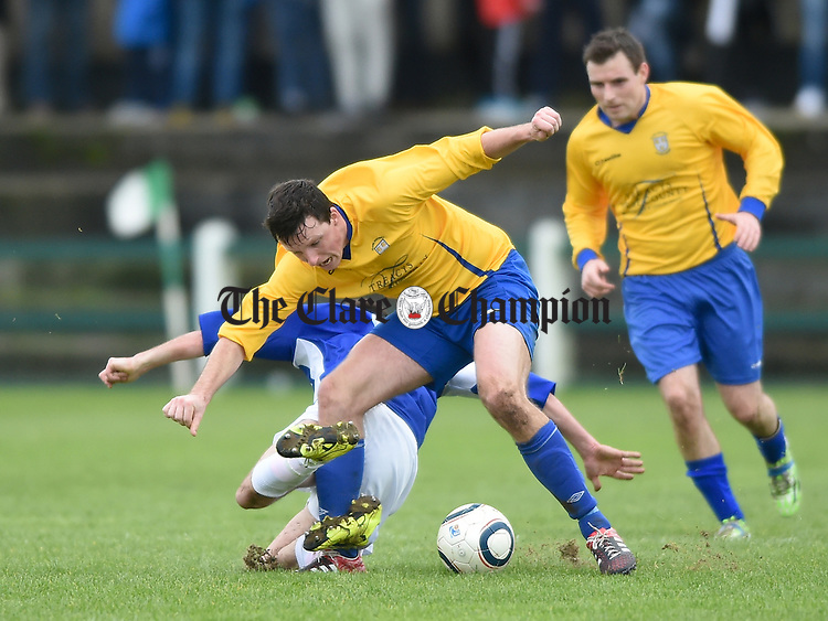 Stephen Kelly of Clare in action against Paudie Quinn of Limerick during their FAI Oscar Traynor game in Limerick. Photograph by John Kelly.