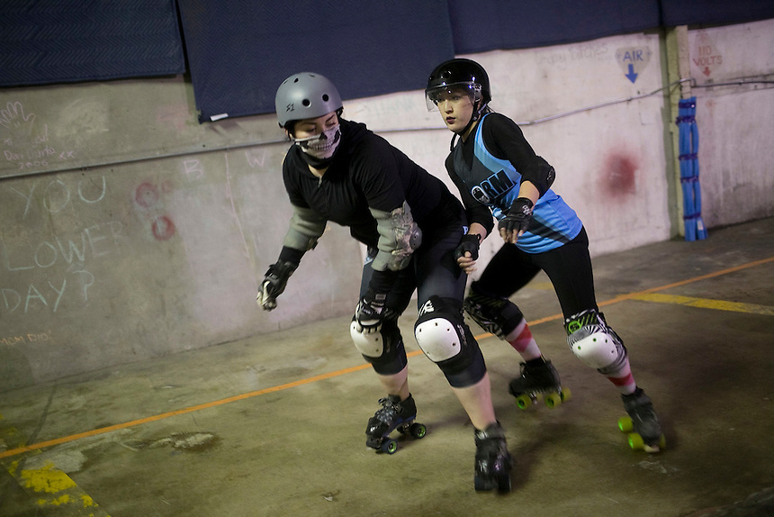 Darkness (L) and Trouble Axle (R) of the Storm City Roller Girls spar during a practice in Vancouver Thursday February 9, 2017. (Photo by Natalie Behring for the Columbian)