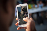 Romeo. an African migrant records with his smartphone the press conference convened by the hosting network of Irun to ask for a dignified and comprehensive reception for migrants in transit. Irun (Basque Country). Sptember 1, 2018. A group of voluntiers have created a hosting network for migrants in transit who have already completed the 5-day period that can remain in public resources. This group of volunteers is avoiding a serious humanitarian problem Irún, the Basque municipality on the border with Hendaye. As the number of migrants arriving on the coasts of southern Spain incresead, more and more migrants are heading north to the border city of Irun. (Gari Garaialde / Bostok Photo) (Gari Garaialde / BostokPhoto)