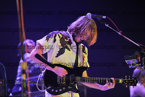 Arcade Fire - guitarist Richard Reed Parry - performing live on The Suburbs Tour at the O2 Arena London UK - 01 Dec 2010.  Photo credit: Zaine Lewis/IconicPix