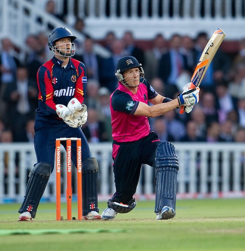 Middlesex Panthers' Joe Denly hits to long on, watched on by Essex Eagles' James Foster<br /> <br />  (Photo by Ashley Western/CameraSport) <br /> County Cricket - Friends Life t20 2013 - Middlesex v Essex - Thursday 04th July 2013 - Lord's, London <br /> <br />  &copy; CameraSport - 43 Linden Ave. Countesthorpe. Leicester. England. LE8 5PG - Tel: +44 (0) 116 277 4147 - admin@camerasport.com - www.camerasport.com